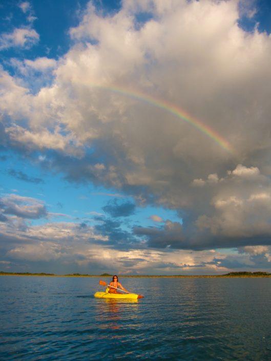 Kayak under the rainbow on Laguna Bacalar